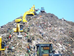 Mountain of garbage in bantar gebang with some excavator scaled