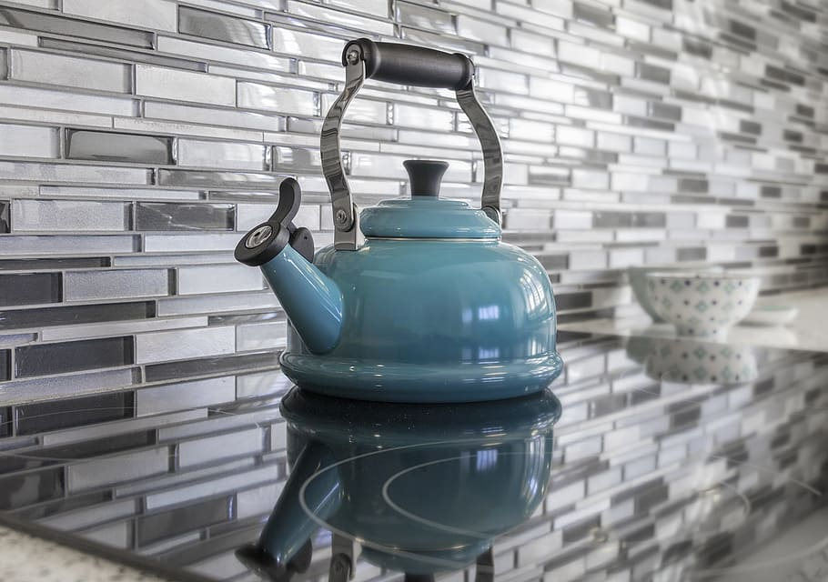 Kitchen teapot blue glass tile