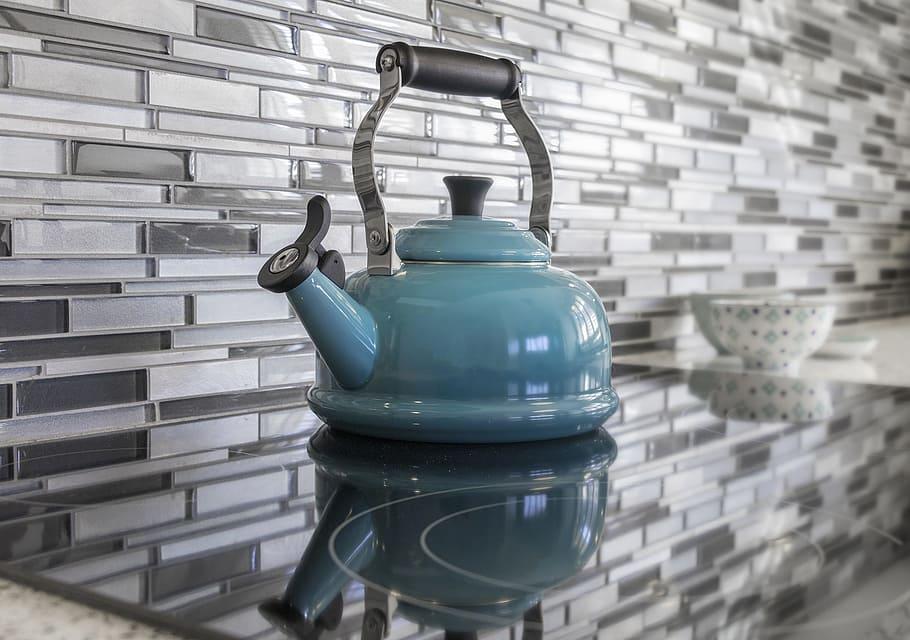 Kitchen teapot blue glass tile
